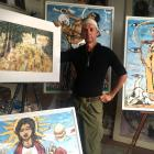 Artist Eion Shanks with some of his recent paintings. PHOTO: SUPPLIED