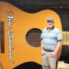 Gore Country Music Club member Alan Ritchie stands with the giant guitar that has been on display...