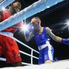 New Zealand's Richard Hadlow competes against Edrian Volcree of the Seychelle's during the Boxing...
