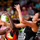 Stella Nanfuka of Uganda and Ameliaranne Ekenasio of New Zealand compete for the ball during the...