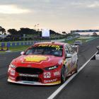 Scott McLaughlin takes the chequered flag during the Supercars Phillip Island 500. Photos: Getty...