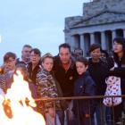 People gather at Melbourne's Shrine of Remembrance to pay their respects during the city's Anzac...