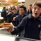 King's High School pupil Zac Bell (14) gets his well-earned lunch at the school canteen. PHOTO:...