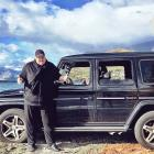 Kim Dotcom with his Mercedes SUV on the shores of the lake in Queenstown. Photo: Twitter