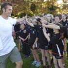 Fairfield School pupils greet Richie McCaw at their school today.. Photo: Gerard O'Brien
