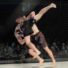 James McBride (Universal Vale Tudo, Christchurch, facing camera) tips over and takes down Flynn...