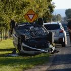 Two people sustained injuries after their car flipped on Dukes Rd today. Photo: Gerard O'Brien