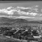 Something's missing in this wonderful old photograph of Dunedin, taken from the hill at St Clair...