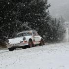 Allan Dippie, of Dunedin, powers his Porsche 911 into a corner as snow falls in Flagstaff...