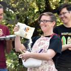 Otago University Students' Association queer support co-ordinator Hahna Briggs (centre) gets...