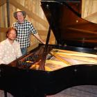 Pianist Jonathan Crayford sits at a 1955 Steinway D concert grand piano which he played in...