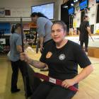 Top open woolhandler Pagan Karauria, of Alexandra, takes a moment to relax while competing at the...