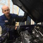 DNA Auto Services owner-operator Dave Atkins, of Mosgiel, checks the oil level of a Mini at his...