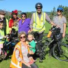 Looking forward to the big day are residents with their electric bikes (back, from left) Alasdair...