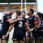 Warriors players celebrate a try during their first game of the season against Newcastle. Photo:...