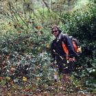 Jarrad Kennedy, of the Malcam Charitable Trust, clears leaves from paths following strong gales...