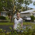 Surrey St resident Callum Walker (17) next to some of the branches ripped from a tree by a mini...