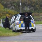 Police dog handlers at the scene where George Warren was arrested, just north of Arahura township...
