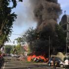 Motorcycles burn following a blast at the Pentecost Church Central Surabaya. Photo: Reuters