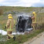 Firefighters put out a car fire near Alexandra this afternoon. PHOTO: TOM KITCHIN