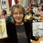 Cathy Fitzsimons teaches budding crafters how to turn books into art at the Regent Theatre on...