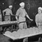 The W.A.A.C baking bread for the troops in France: putting dough into the ovens. - Otago Witness,...
