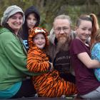 Ottley family members Morgie (9), Jen, Sam (11), Lilly (8), Garreth, Lori (12) and Soraya (7) sit...