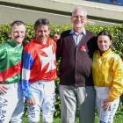 Jockeys Terry Moseley, Chris Johnson and Samantha Wynne with longtime Wingatui race day official...