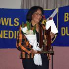 Malia Tavite holds  the Millie Khan Memorial Trophy   which she was awarded    at the Taieri...