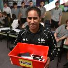 East Otago High School year 9 teacher Johnny Herewini holds the box used to store pupils' mobile...