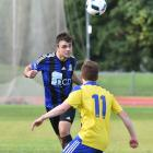 Queenstown's Cohen Nash heads the ball down field as University's Amon Tapp challenges during the...