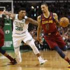 Cavs guard George Hill drives as he is trailed by Celtics defender Marcus Smart. Photo: Getty Images