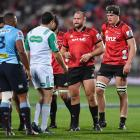 Crusaders prop Joe Moody (2nd R) talks to the referee during last night's match. Photo: Getty
