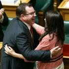 Finance Minister Grant Robertson is embraced by Prime Minister Jacinda Ardern after his 2018...