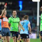 Referee Brendon Pickerill shows Highlanders winger Tevita Nabura a red card as co-captain Ben...