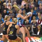 Southern Steel wing attack Gina Crampton leaps to take the ball in front of Waikato-Bay of Plenty...