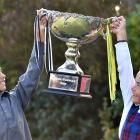 Kairangi (9) and Anahera Koni (8) hold aloft the transtasman trophy they helped win. Photo: Peter...