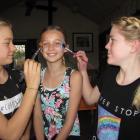 Lauren Rimmer and Maisy Millwater, of Hawea Flat, use non-plastic ''bio-glitter'' on model Tia...