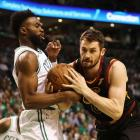 Kevin Love (right) in action for the Cleveland Cavaliers as he is guarded by Boston Celtics guard...