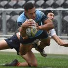 King's High School First XV second five-eighth Giovanni Leituala is  caught by John McGlashan...