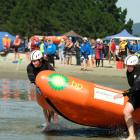 St Clair sisters Carla (left) and Steph Laughton push their boat into the water at the South...