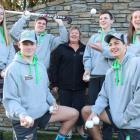 Dunstan High School students and the ball boy/girl coach, Sandra Stuart, look forward to their...