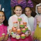 Selling cup cakes are (from left) Isabella Newell (11), Jorja Livingstone-Wood, Zoe Bennetts and...