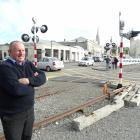 Oamaru Steam and Rail Society general manager Harry Andrew  observes traffic on Humber St...
