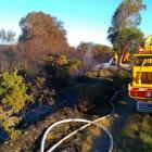 Waitaki rural firefighters control a blaze on a Waitaki River island in January 2016. Fire and...