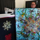 Weston-based quilter Mathea Daunheimer shows an example of a large quilt she has just completed...
