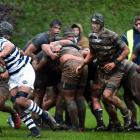 Otago Boys' High School replacement No8 Taniora Raneira (centre) carts the ball up against...