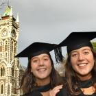 Identical twins Renee (left) and Stephanie Oliver (22) prepare to graduate from the University of...