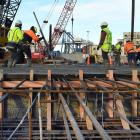 Concrete placers and finishers at Port Otago put the finishing touches on the latest wharf...