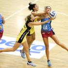 Pulse defenders Katrina Grant and Sulu Fitzpatrick stop the ball getting to Steel goal attack Te...